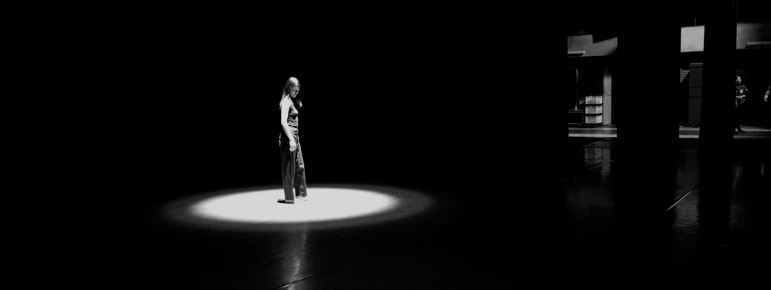 Dancer standing in a spotlight